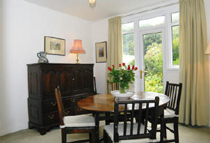 Dining Room at Drift Cottage, Self catering accommodation in Dale Pembrokeshire near West Dale and Dale Beaches. Ideal for windsurfing, sailing, diving, birdwatching, walking.
