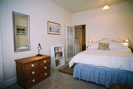 Bedroom at Cliff Cottage, Self catering accommodation in Dale Pembrokeshire near West Dale and Dale Beaches. Ideal for windsurfing, sailing, diving, birdwatching, walking.